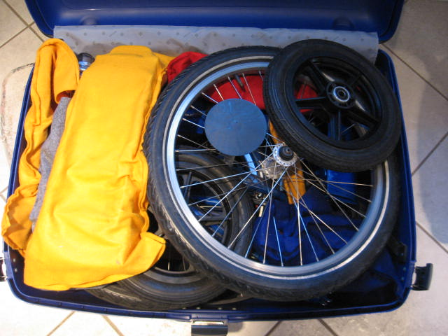 Bike packed suitcase ready to close