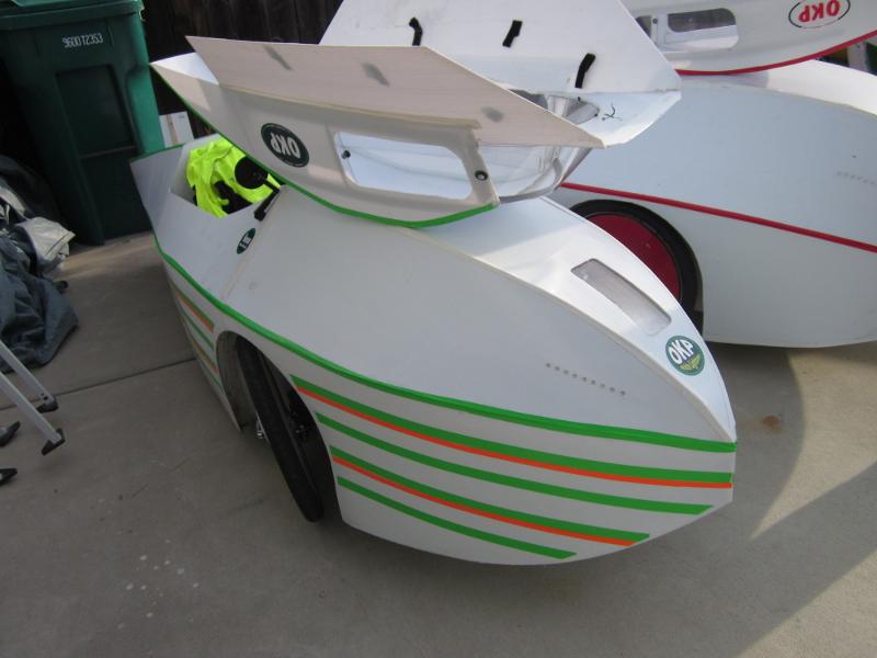 Two homebuilt, coroplast velomobiles
